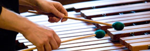 Hands playing the Xylophone