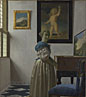 Johannes Vermeer: 'A Young Woman standing at a Virginal'