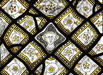 Detail from 'Stained Glass Panel with Quarries and a Female Head', about 1320-4 Paris © Victoria and Albert Museum, London