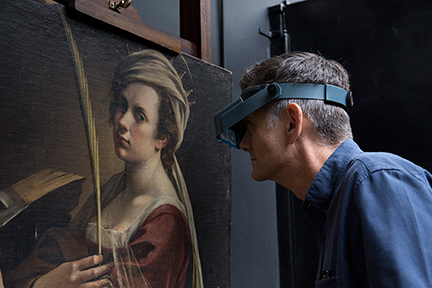 Larry Keith, Head of Conservation at the National Gallery, inspects Artemisia Gentileschi's 'Self Portrait as Saint Catherine of Alexandria'