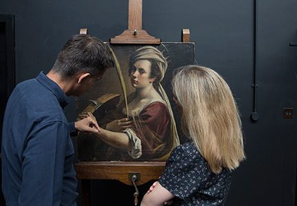 The curator and conservation expert look at the painting