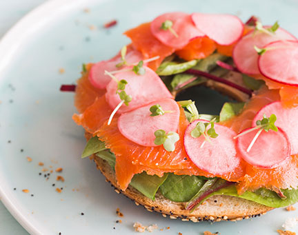 Smoked salmon bagel with radishes and cress
