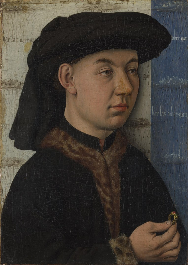 A Young Man holding a Ring by Follower of Jan van Eyck
