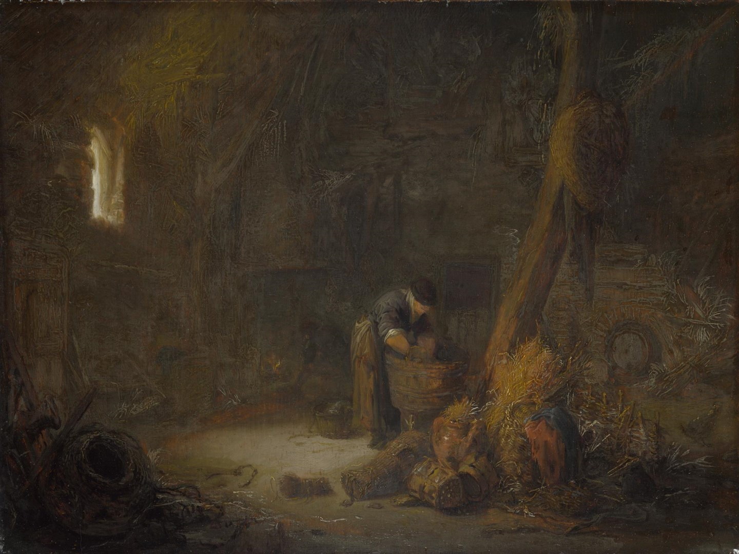 The Interior of a Barn with Two Peasants by Isack van Ostade