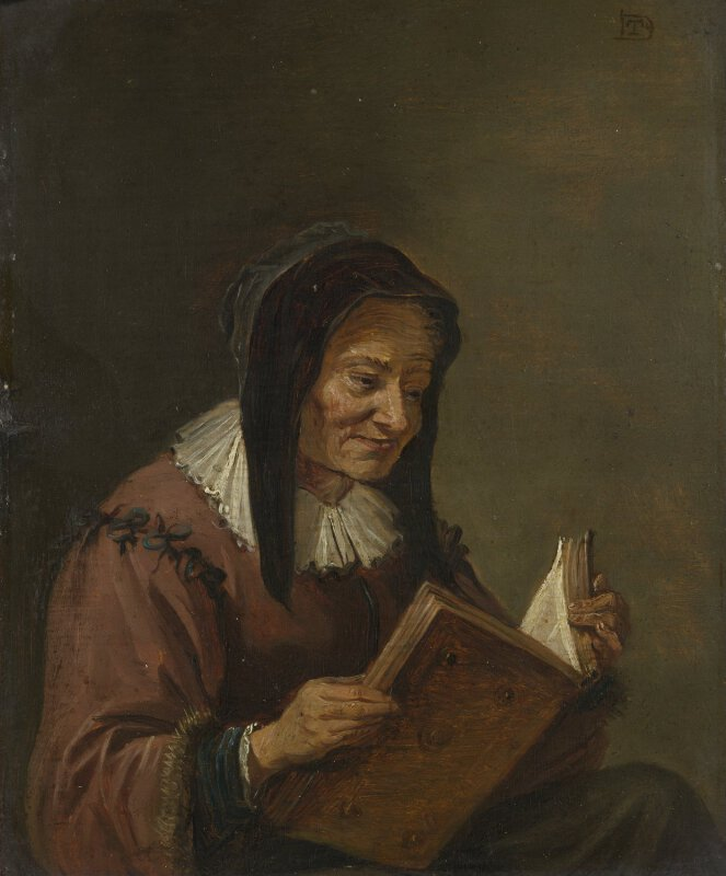 imitator of david teniers the younger an old woman reading
