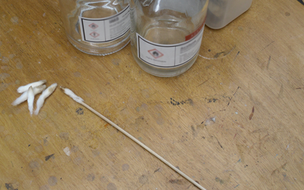 Cotton wool swabs are dipped into the chosen solvent mixture and used by the conservator to carefully remove discoloured varnish.