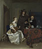 A Woman playing a Lute to Two Men
