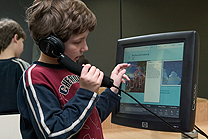 A boy using Artstart and listening to an explanation