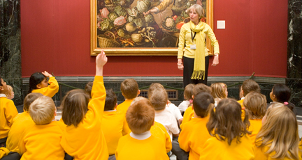 Children listen to a talk on a National Gallery painting