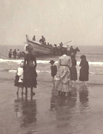 Victorian beach scene, woman and children watching boat