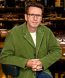 A portrait of Oliver Peyton in the National Dining Rooms