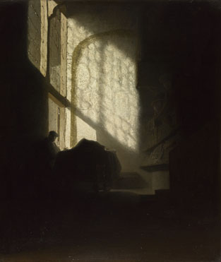 Follower of Rembrandt: 'A Man seated reading at a Table in a Lofty Room'
