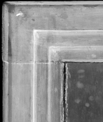 Detail from the x-radiograph of the upper-right corner of 'Margaret, the Artist's Wife' painting by Jan van Eyck, 1439